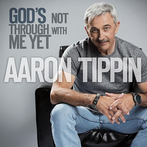 Play & Download God's Not Through With Me Yet by Aaron Tippin | Napster