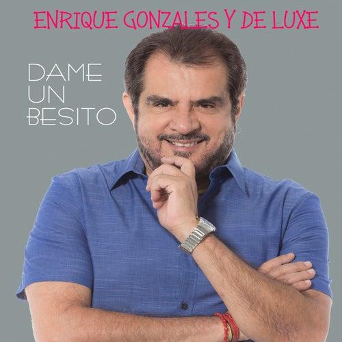 Play & Download Dame un Besito by Enrique Gonzales y De Luxe | Napster