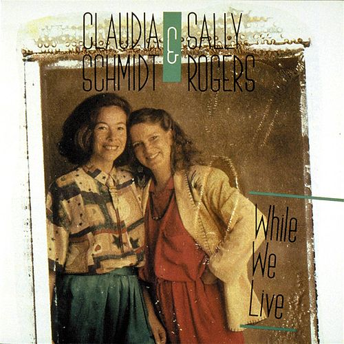 Play & Download While We Live by Claudia Schmidt | Napster