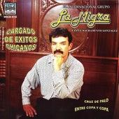 Cargados De Exitos Cargados by Grupo La Migra