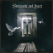Play & Download Never Alone by Stitched Up Heart | Napster