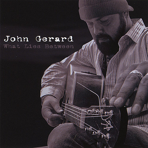 Play & Download What Lies Between by John Gerard | Napster