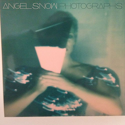 Play & Download Photographs by Angel Snow | Napster