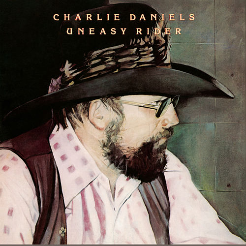 Play & Download Uneasy Rider by Charlie Daniels | Napster