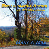 Play & Download Many A Mile (feat. Tom Gray & Friends) by Eddie and Martha Adcock | Napster