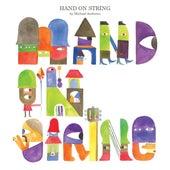 Hand On String von Michael Andrews