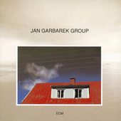Photo With Blue Sky, White Cloud, Wires, Windows And A Red R de Jan Garbarek