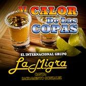 Al Calor De Las Copas by La Migra