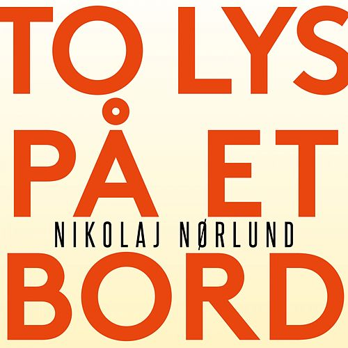 To lys på et bord by Nikolaj Nørlund