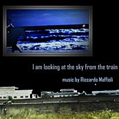 I am looking at the sky from the train by Riccardo Maffioli