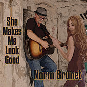 She Makes Me Look Good by Norm Brunet