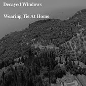 Wearing Tie at Home by Decayed Windows