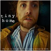 The rope is cold and wet and slipping through my hands. de Tiny Home