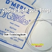 Couple of Broken Guitar Strings by Tom Cunningham