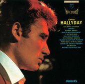 Les bras en croix de Johnny Hallyday