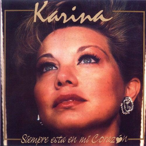 Siempre está en mi corazón by Karina