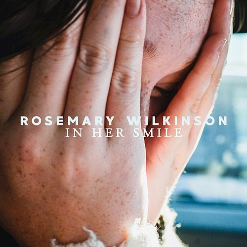 In her smile by Rosemary Wilkinson
