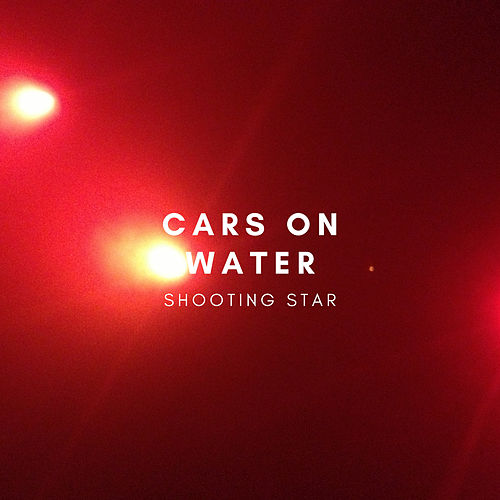 Shooting Star by Cars On Water